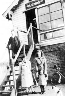 Pat outside the cabin with The Kenny family during the war years