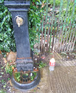 The water tap located in the graveyard at the parish church and one of the plastic bottles
