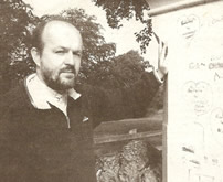 The Rev. Earl Storey beside one of the church pillars defaced at St. Aidan's - Ulster Star